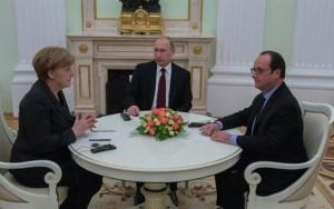 Il Presidente Vladimir Putin, la cancelliera Angela Merkel e il Presidente François Hollande