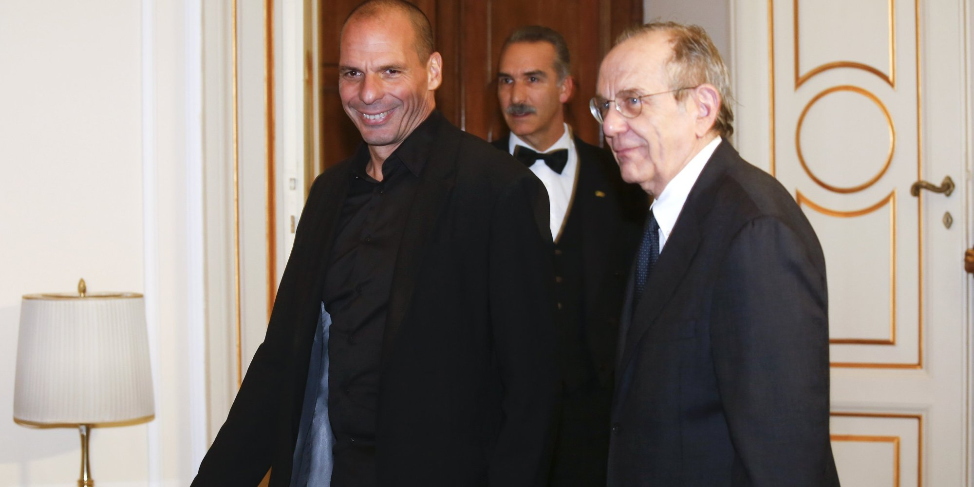 Greek Finance Minister Varoufakis walks next his Italian counterpart Pier Carlo Padoan during a meeting in Rome