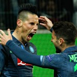 Napoli's Marek Hamsik celebrates with Dries Mertens after scoring his second goal against Wolfsburg