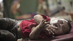 Un bambino ferito in un'infermieria di Gaza Foto: The Telegraph