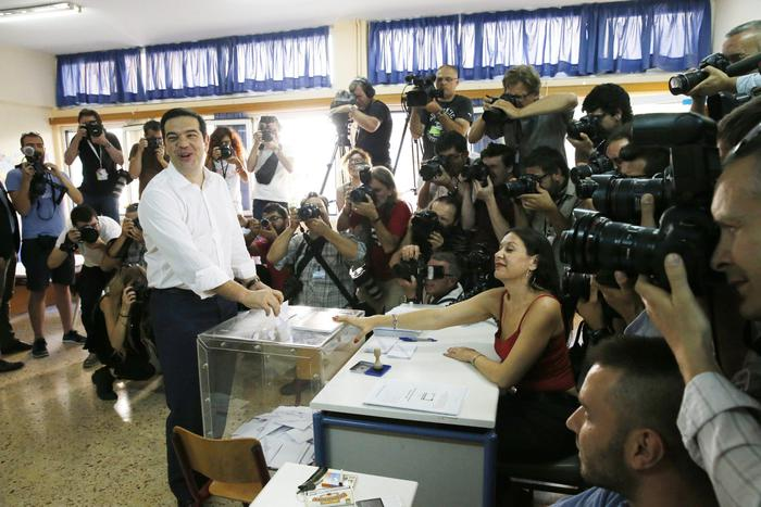 Greek Prime Minister Alexis Tsipras casts his ballot in a voting centre during a referendum in Athens, Greece, 05 July 2015. Greek voters in the referendum are asked whether the country should accept reform proposals made by its creditors.  ANSA/ARMANDO BABANI