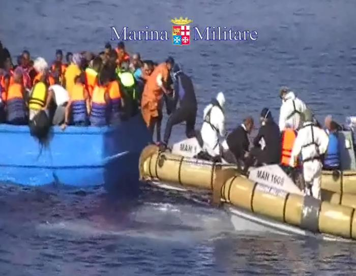 A handout provided on 15 August 2015 and released by the Italian Navy showing migrants on a boat during rescue operation south of Lampedusa island, in the Mediterranean Sea. Italian Navy ships rescued today a boat with almost 400 migrants, 40 of them dead asphyxiated in the hold. ANSA/ US MARINA MILITARE - ITALIAN NAVY PRESS OFFICE ++ANSA PROVIDES ACCESS TO THIS HANDOUT PHOTO TO BE USED SOLELY TO ILLUSTRATE NEWS REPORTING OR COMMENTARY ON THE FACTS OR EVENTS DEPICTED IN THIS IMAGE; NO ARCHIVING; NO LICENSING++