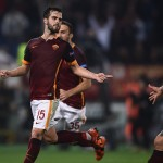Roma's midfielder from Bosnia-Herzegovina Miralem Pjanic (L) celebrates with teammates after scoring a penalty during the UEFA Champions League football match AS Roma vs Bayer Leverkusen on November 4, 2015 at the Olympic stadium in Rome.    AFP PHOTO / FILIPPO MONTEFORTE        (Photo credit should read FILIPPO MONTEFORTE/AFP/Getty Images)